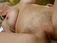 Busty old bitch getting her hairy pussy fucked
