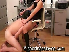 A mistress in the office makes a slave worship her boots