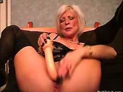 Blonde mature granny toying her pierced pussy