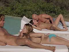 Two couples banging together outside