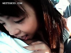 Asian stunning teen beauty rubbing her tits in close-up