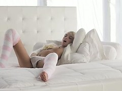 Blonde model Emma Mae in sexy kneesocks