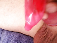 Sissy clit cums in a condom