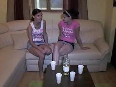 Two ladies jump on hard rods