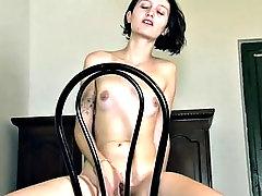 venus masturbates on her wooden table