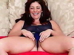 Sheer top and blue panties on a cute milf