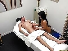 Experienced Asian gal blows and rides dick on massage table