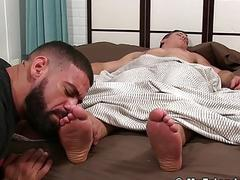 Ricky Larkin treats sleeping JC with a good foot licking