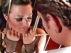 Caged skank Belladonna gets mouth fucked by Nacho Vidal BDSM
