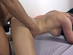 big breasted woman fucks missionary style on the bed