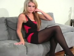 Hot seductress exposes ass and tiny twat in pantyhose