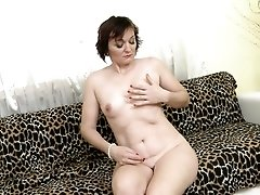 Fishnet pantyhose look hot on a solo teasing milf