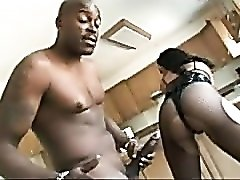 Latex corset on this black whore