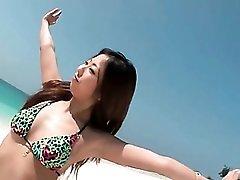 Beautiful bikini girl on the beach groped by guys