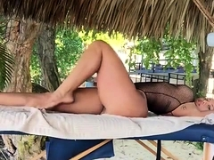 Sporty girl with massive natural tits flexing on the beach