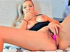 blonde slut fingers her pussy till she cums