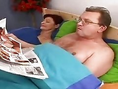 Horny granny sucking old penis in the bed