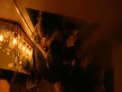 Paz de la Huerta dancing topless on stage at a strip club,